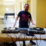 Library Director jack martin DJs at the Rock and Roll Yard Sale at Providence Public library