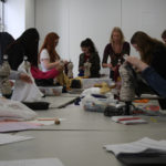 Teen Squad members constructing 1920s style dresses alongside a mentor