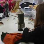 Teen Squad members work on miniature dress forms