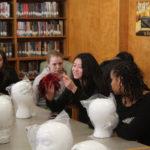Teen Squad members working on a headdress