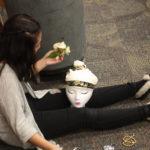 A Teen Squad member decorates a headdress