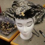 A headdress with a 1920s style flapper headdress on it
