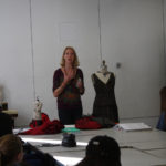 A mentor discusses dressmaking as part of a Teen Squad program