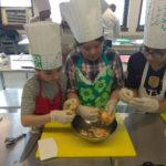 Teen Squad members preparing food