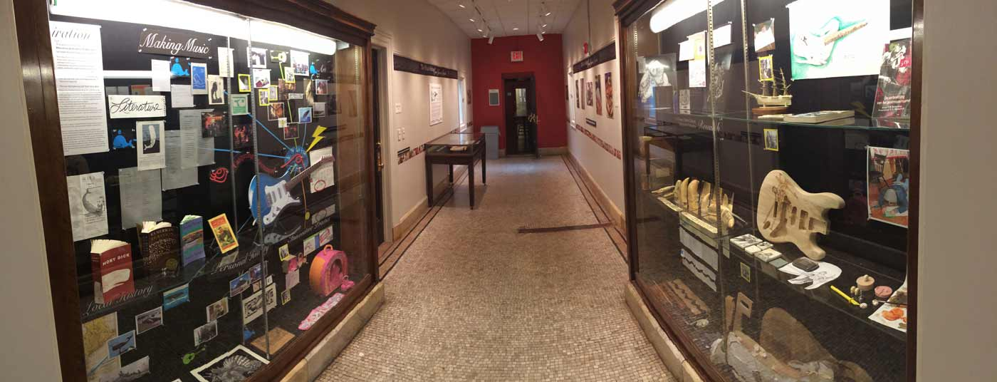 Exhibition cases outside of Special Collections at PPL, featuring the Whale Guitar.
