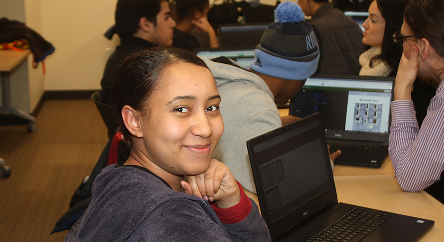 A participant in a PPL Teen Squad Programs smiles at the camera.