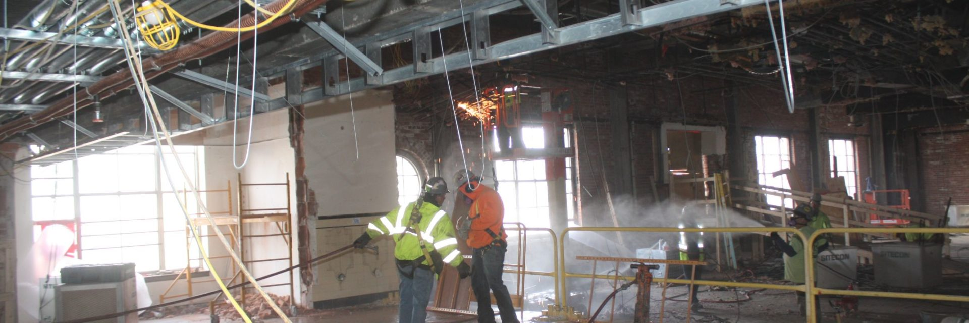 Jackhammering for 3-story Atrium Stair